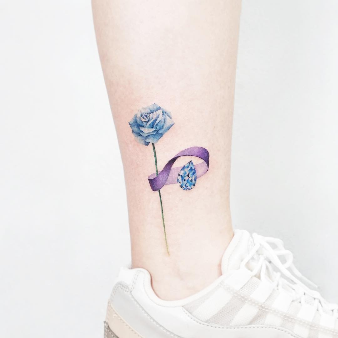 Blue flower and sapphire tattoo by tattooist Ida