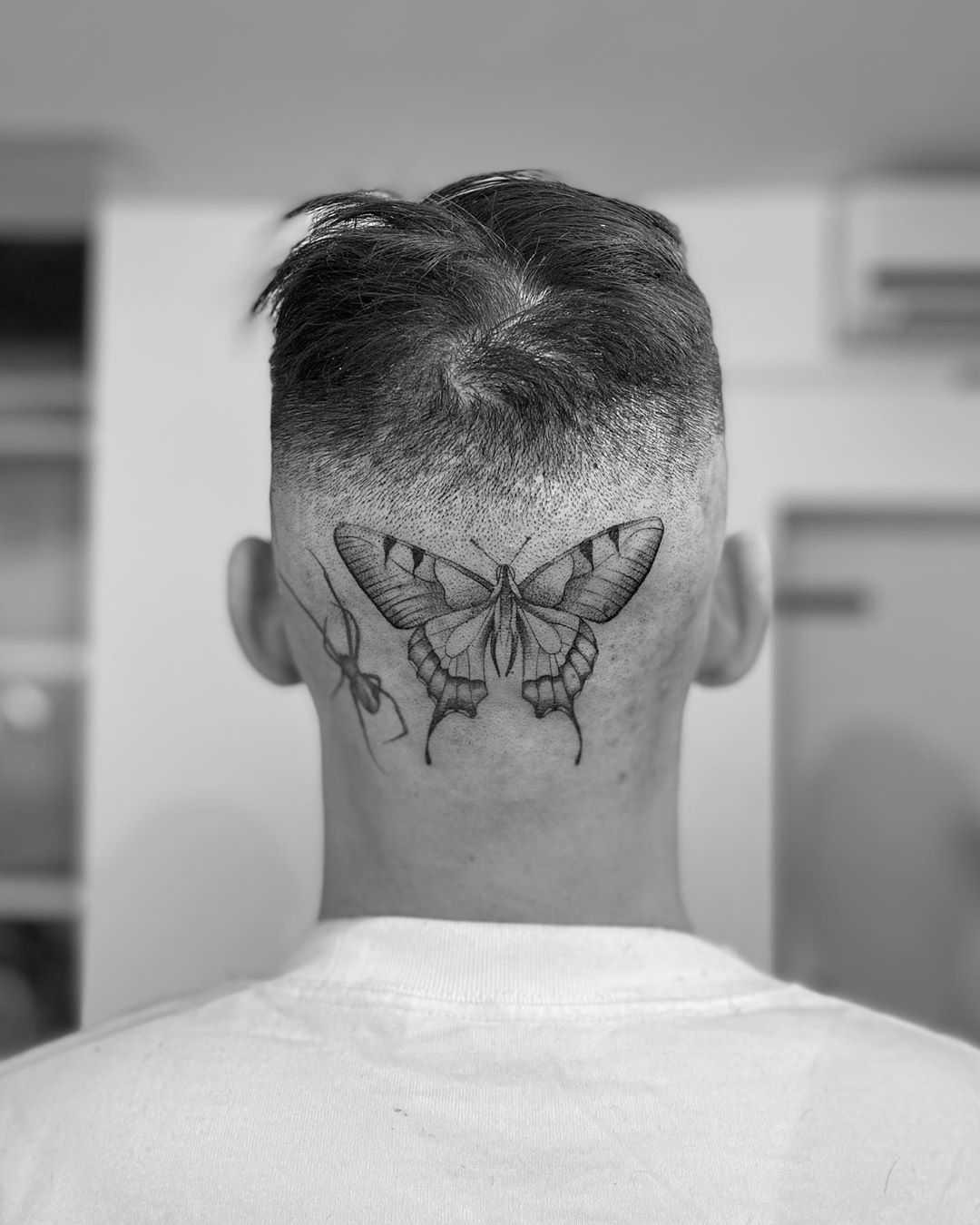 Butterfly on a head by Oscar Jesus