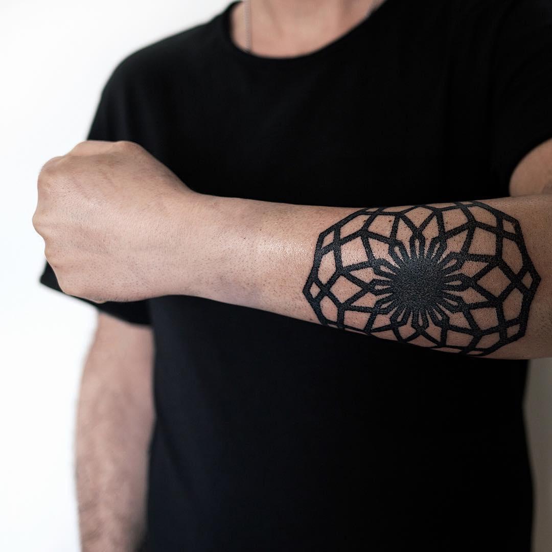 Cool mandala on a forearm by tattooist NEENO