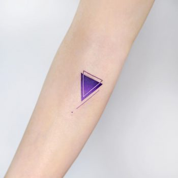 Cover-up purple triangle by tattooist Ida