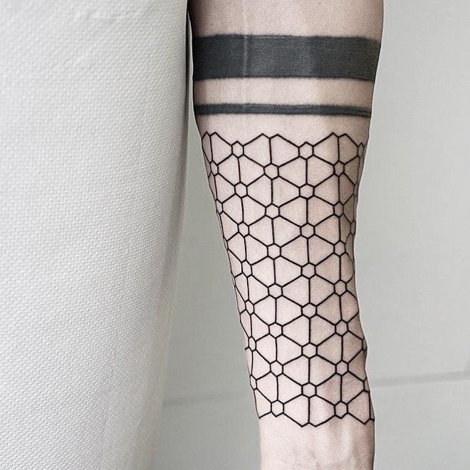 Geometric pattern on the left forearm by Malvina Maria Wisniewska