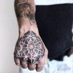 Hand's piece by tattooist NEENO