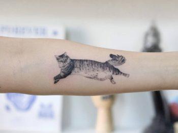 Jumping cat by tattooist Fury Art