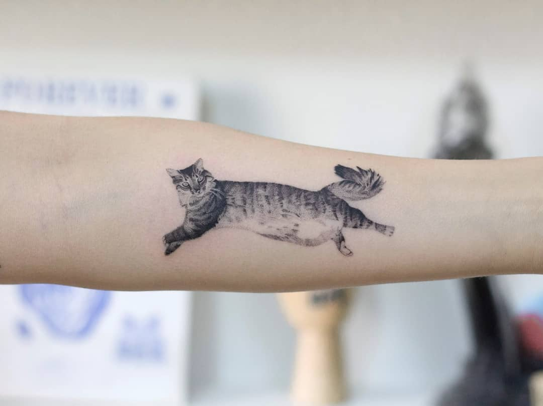 Jumping cat by tattooist Fury Art