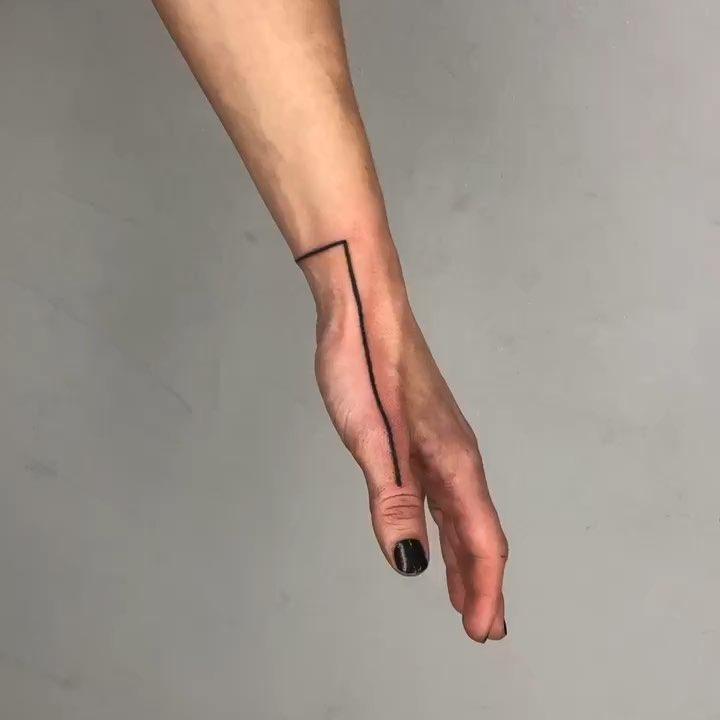 Line on a hand by tattooist MAIC