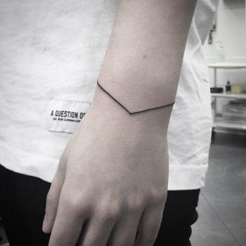 Linear wristband by tattooist Virginia 108