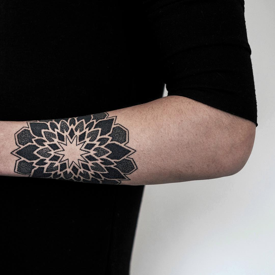 Mandala on the left forearm by tattooist NEENO
