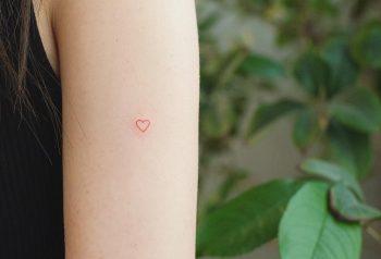 Micro heart by tattooist Franky
