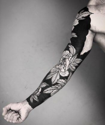 Negative space sleeve by tattooist MAIC