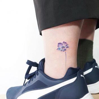Poppy on an ankle by tattooist Ida