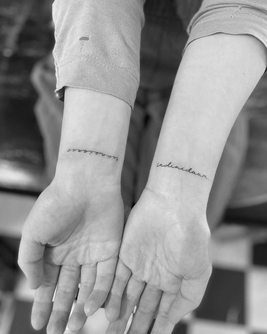 Script on wrists by Oscar Jesus
