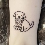 Super cute puppy by tattooist Mr.Heggie
