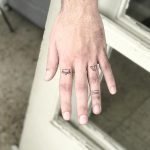 Tiny tattoos on fingers by Sara Kori
