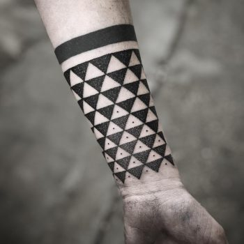 Triangular pattern by tattooist MAIC
