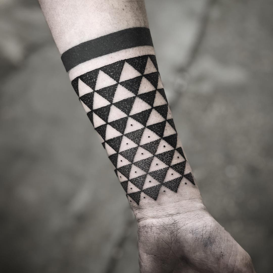 Triangular pattern by tattooist MAIC