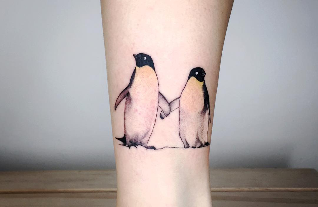 Two penguins by Choco Chiang