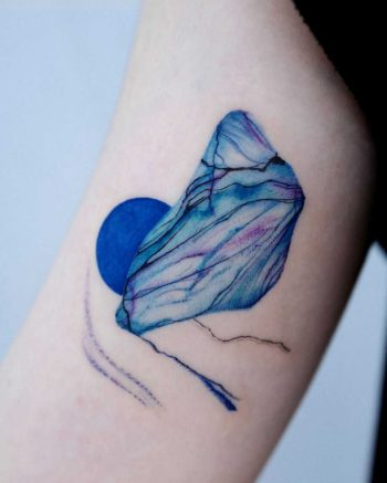Abstract blue piece by @tattoo_a_piece