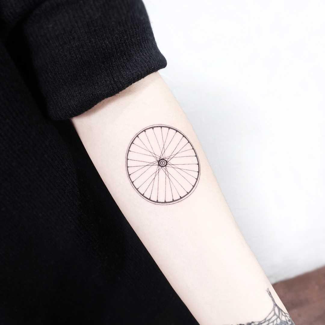 Bicycle wheel tattoo by tattooist Ida