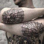Elbow webs by tattooist MAIC
