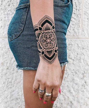 Epic mandala on a wrist by tattooist NEENO
