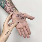 Flower on a palm by Sara Kori