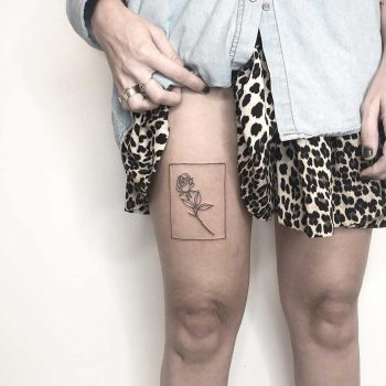 Flower on the right thigh by Sara Kori
