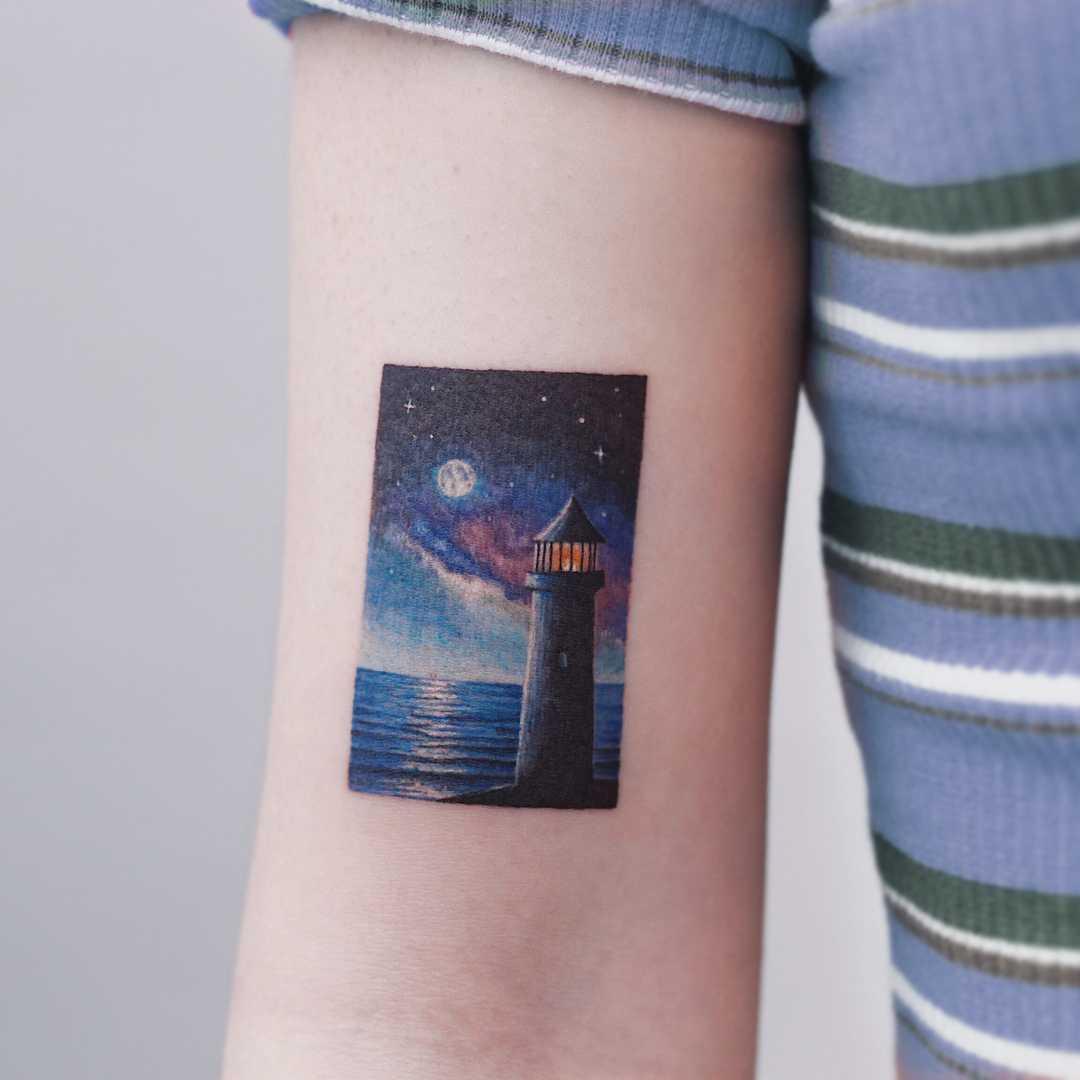 Lighthouse and night sky by tattooist Saegeem