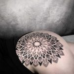 Mandala on the left hip by tattooist NEENO