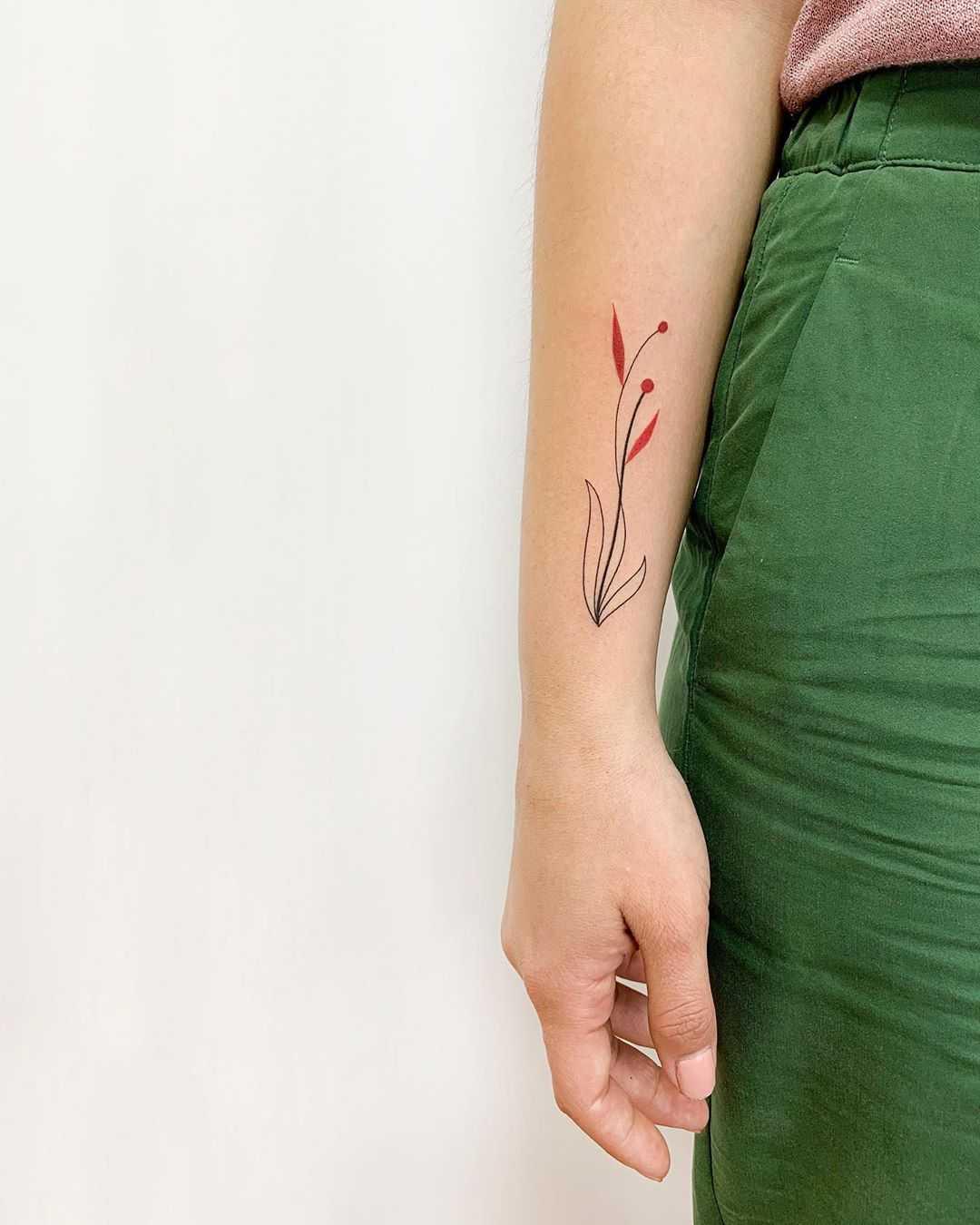 Minimalist flower by tattooist Fury Art