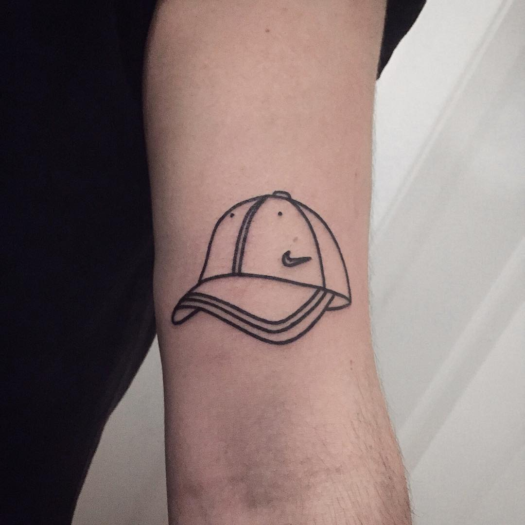 Nike cap tattoo by @themagicrosa