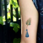 Palm leaf in a vase by tattooist Saegeem