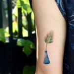 Palm leaf in a vase by tattooist Saegeem