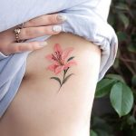 Pink lily tat by tattooist Franky