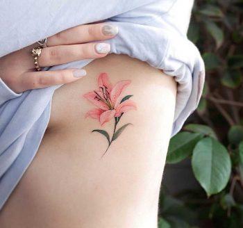 Pink lily tat by tattooist Franky