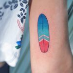 Small surfboard tattoo by @silly_girl_tatts