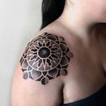 Sun and moon phase inspired mandala by tattooist NEENO