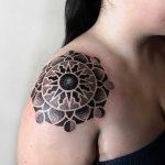 Sun and moon phase inspired mandala by tattooist NEENO