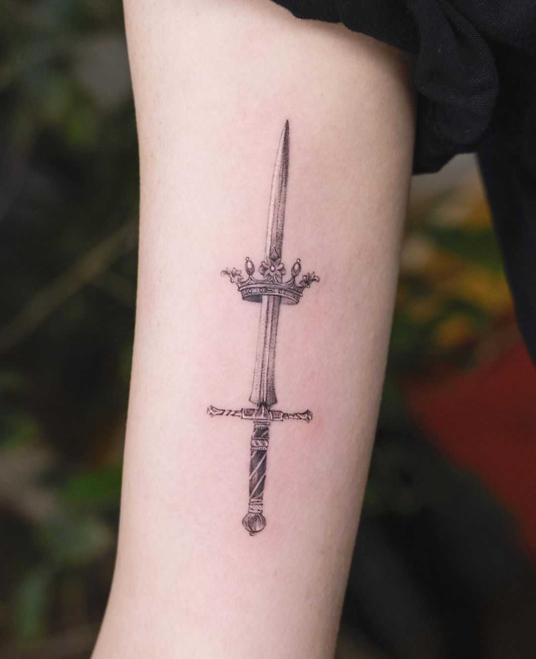 Sword and crown by tattooist Franky