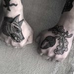 Wolf and acorn by tattooist MAIC