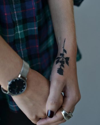 Black rose on a wrist by @tototatuer