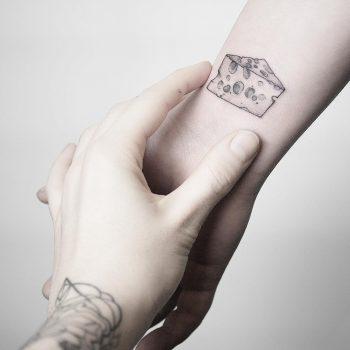 Cheese piece tattoo by @mariafernandeztattoo