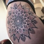 Dot-work style mandala on a hip by @pau1terry_
