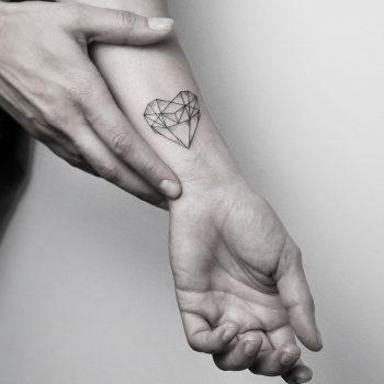 Geometric heart by @mariafernandeztattoo