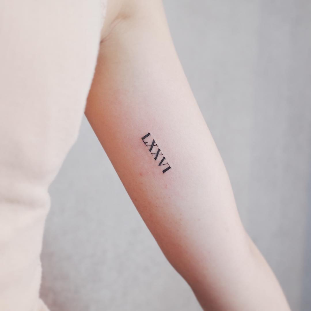 LXXVI tattoo by @wittybutton_tattoo