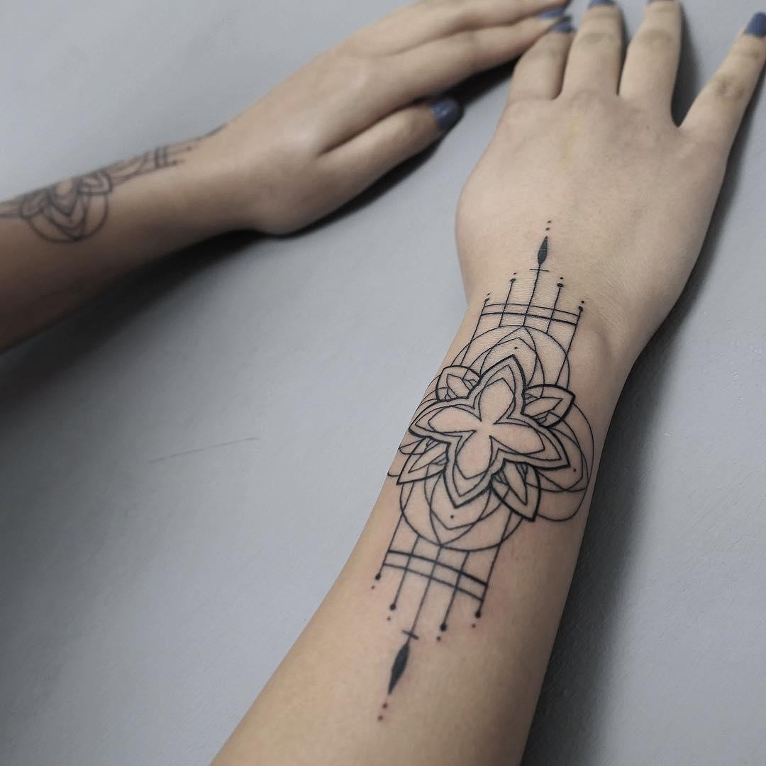 Lotus ornament on a forearm by @hala.chaya