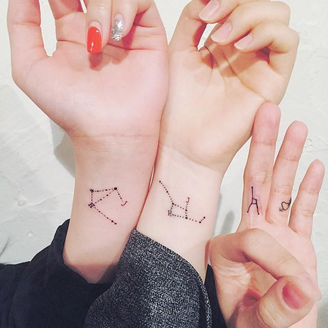 Matching constellations by @wittybutton_tattoo