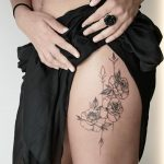 Roses on a thigh by @mariafernandeztattoo