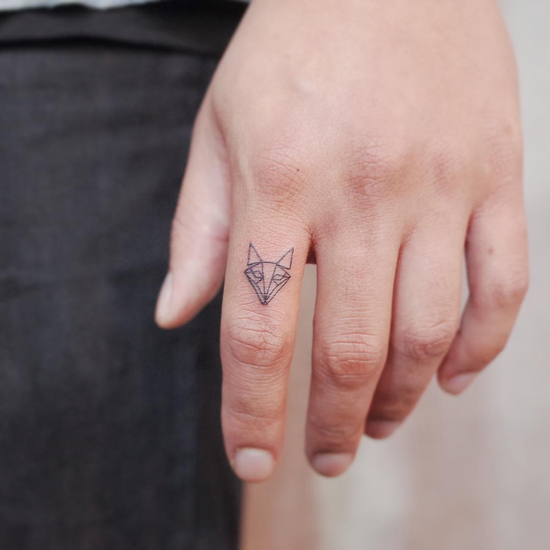 Tiny fox by @wittybutton_tattoo