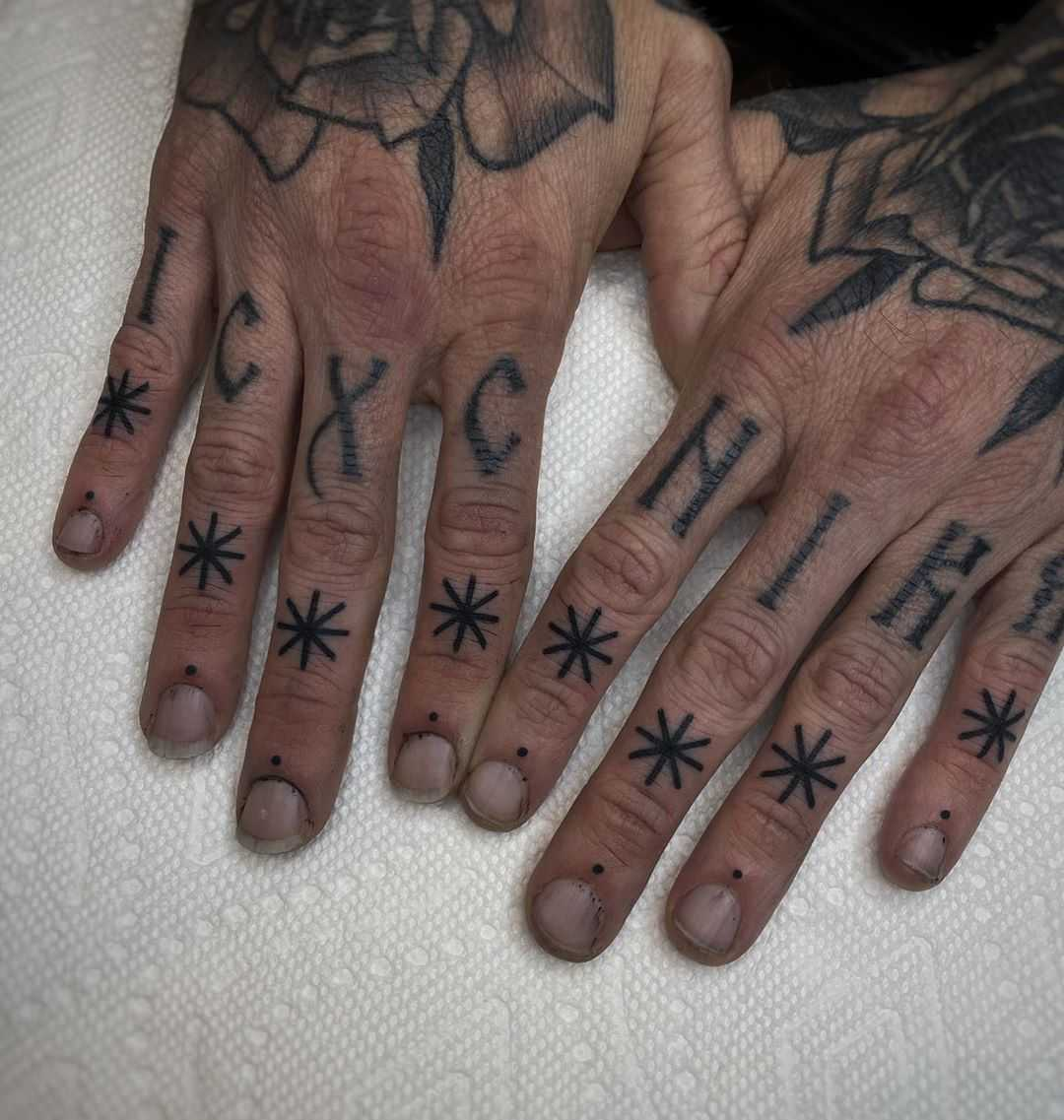 Upper knuckle tattoos by Mark Walker