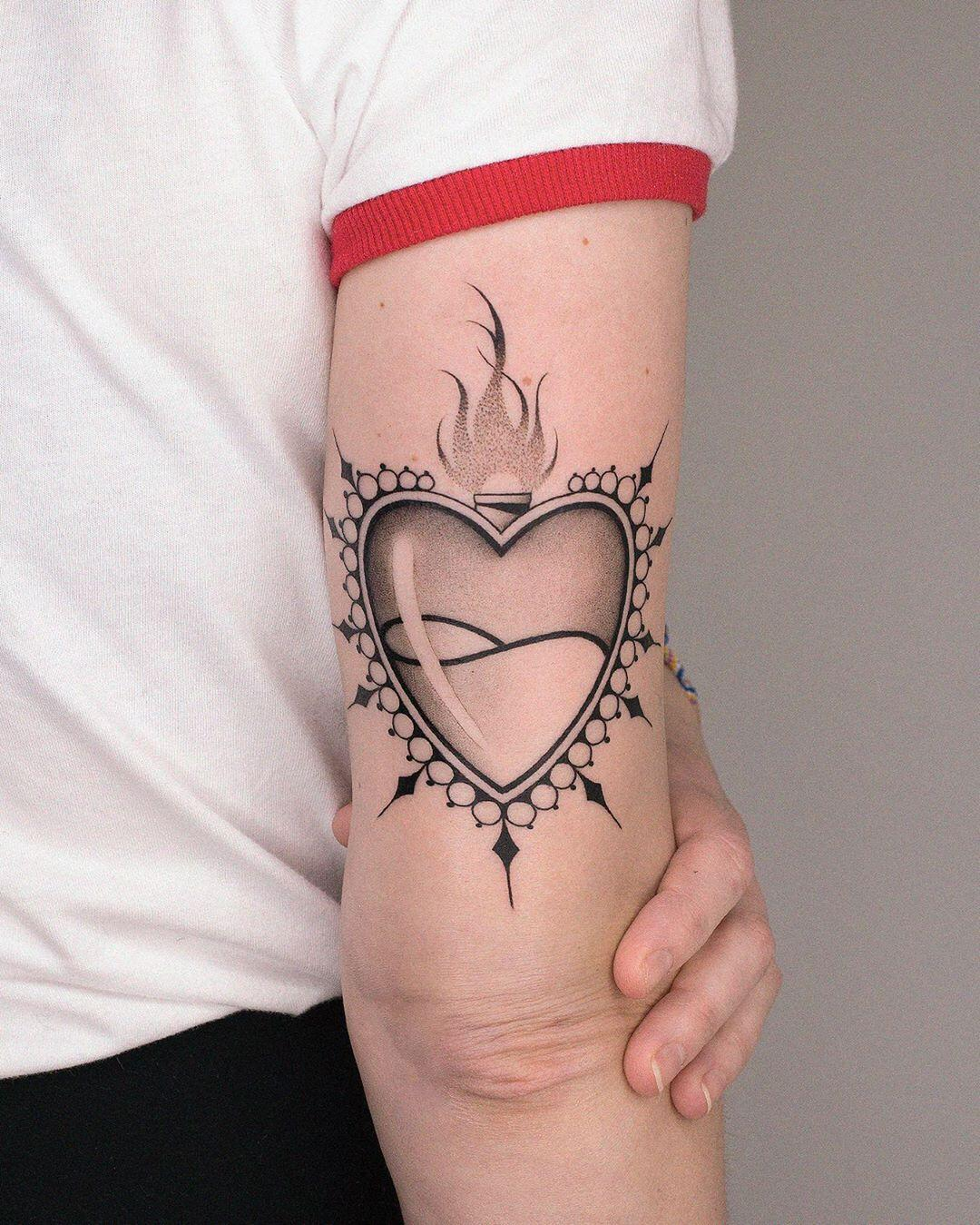 Another sacred heart by @xavtattoo